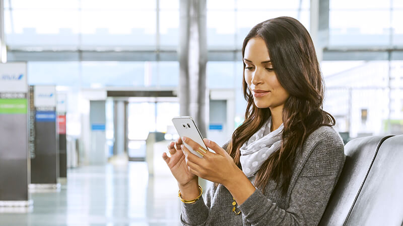 woman at airport mobile location confirmation