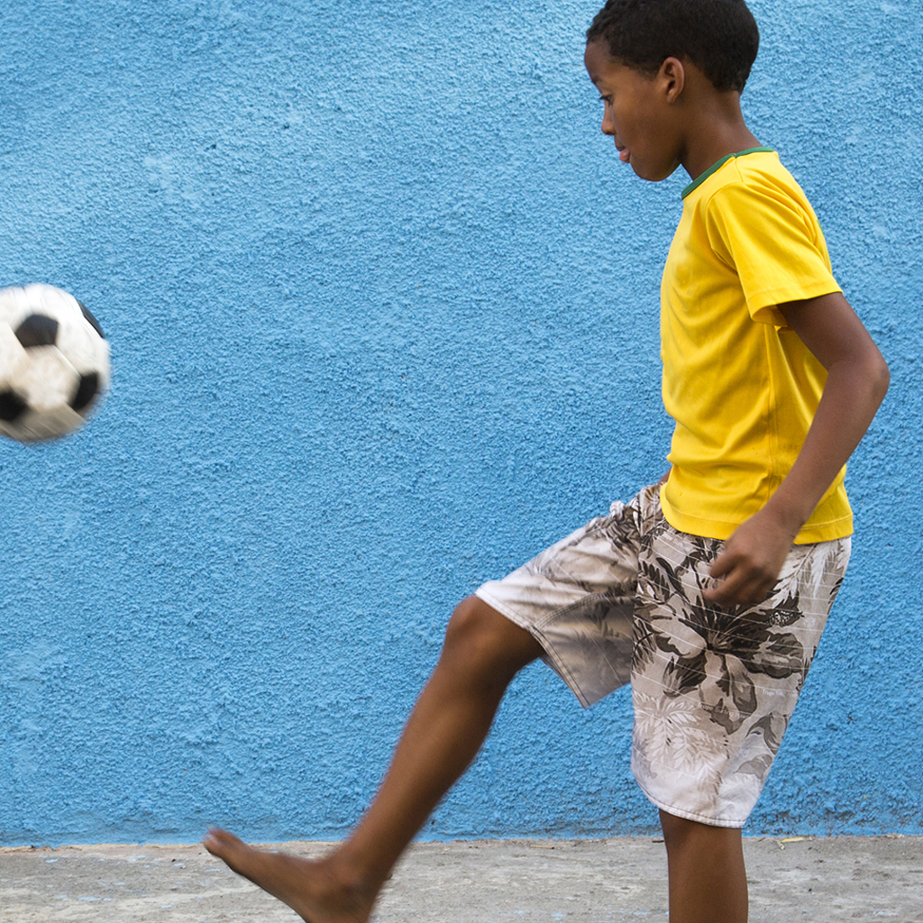 Young boy playing with a soccer ball