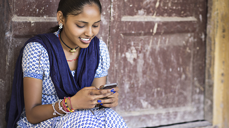 Indian woman with mobile phone