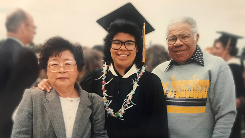 Patty Dingle on graduation day with her parents