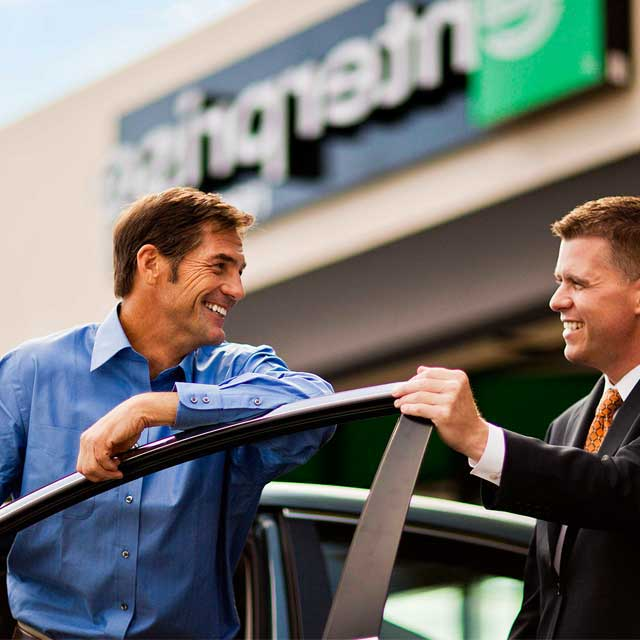 two men in front of Enterprise Rent-a-Car