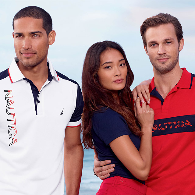 Two men and a woman wearing Nautica gear