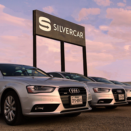 silver audi cars lined up under silvercar sign