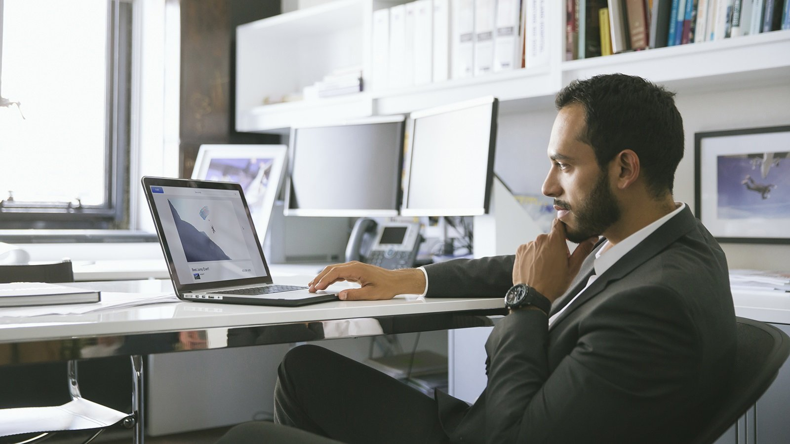 Man at desk using laptop.