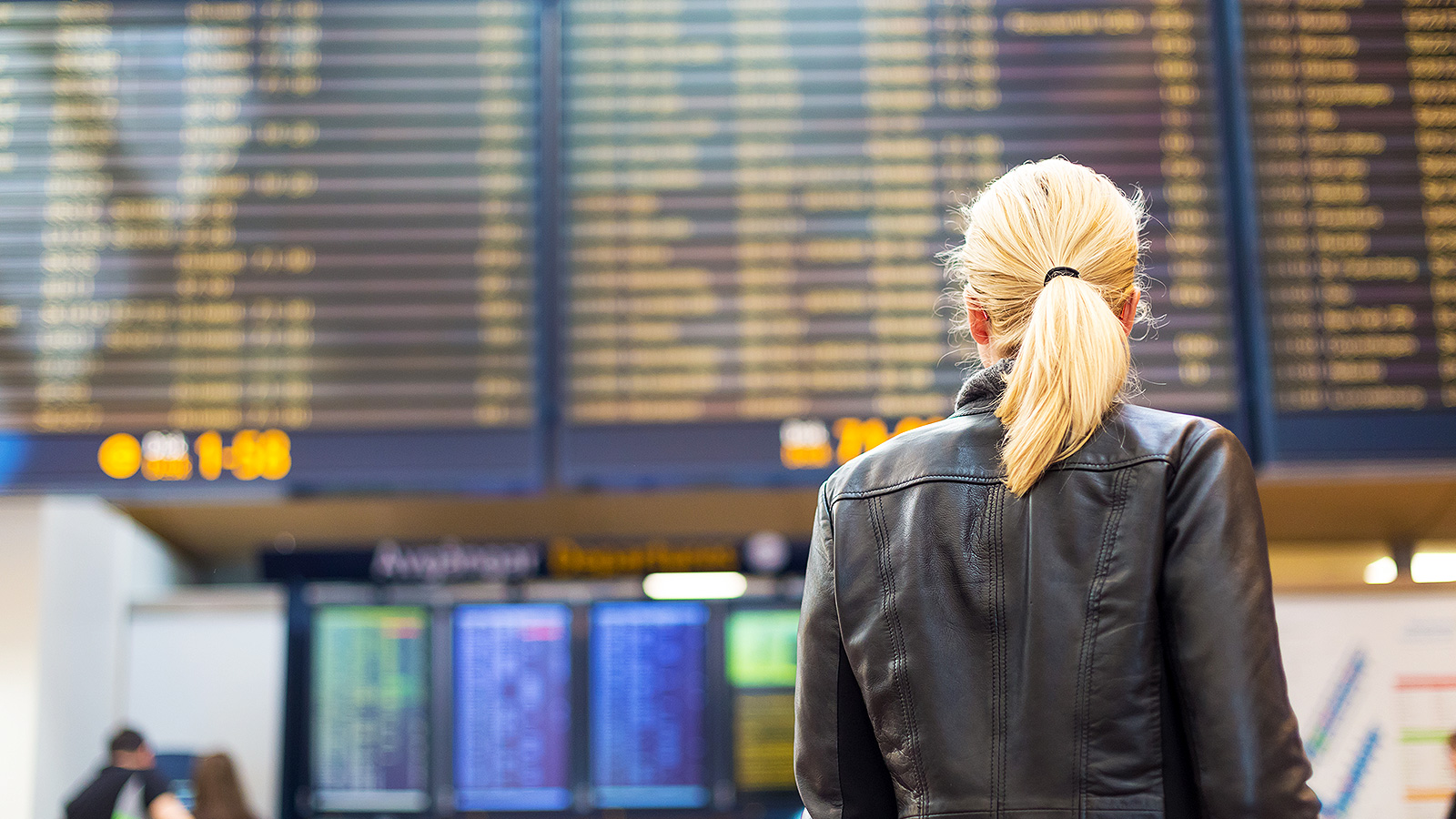 Woman looking at a flight board