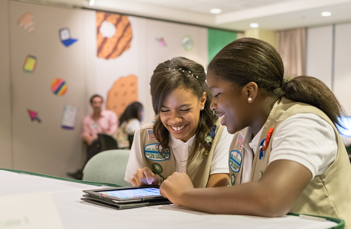 Girl Scouts looking at tablet