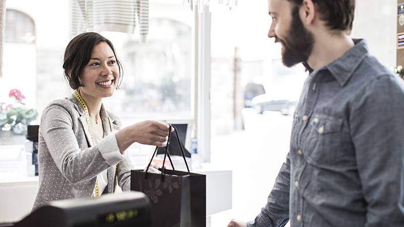 picture of smiling woman making a purchase