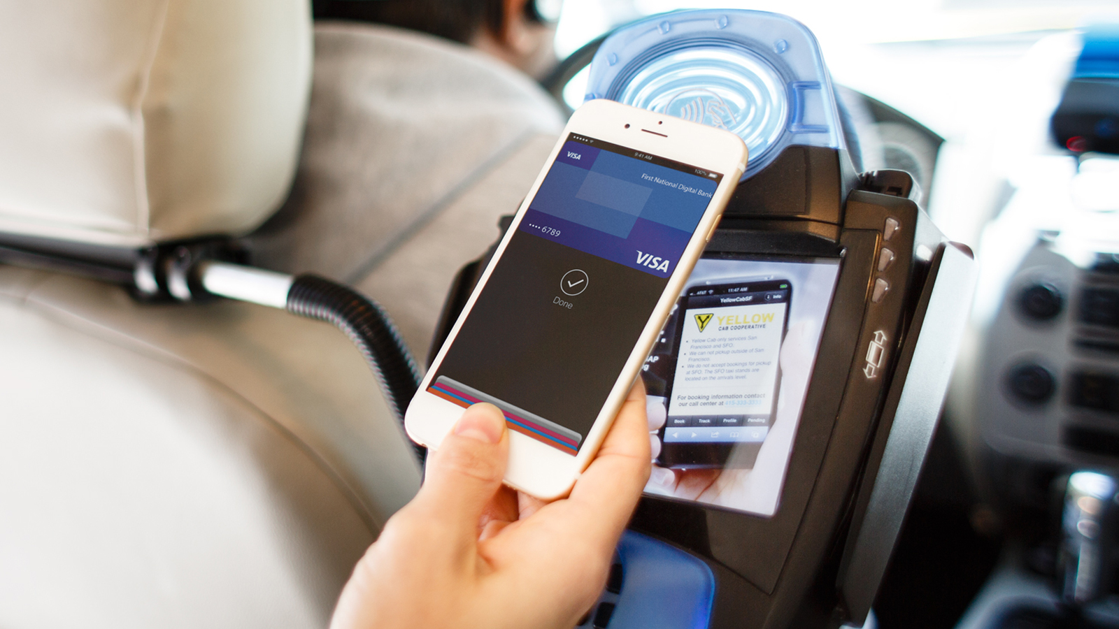 Using Apple Pay at a contactless-enabled terminal inside a taxi.