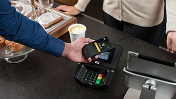 Person making a contactless mobile payment.