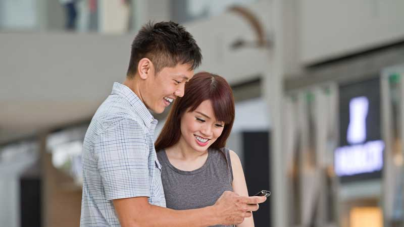 Couple looking at phone
