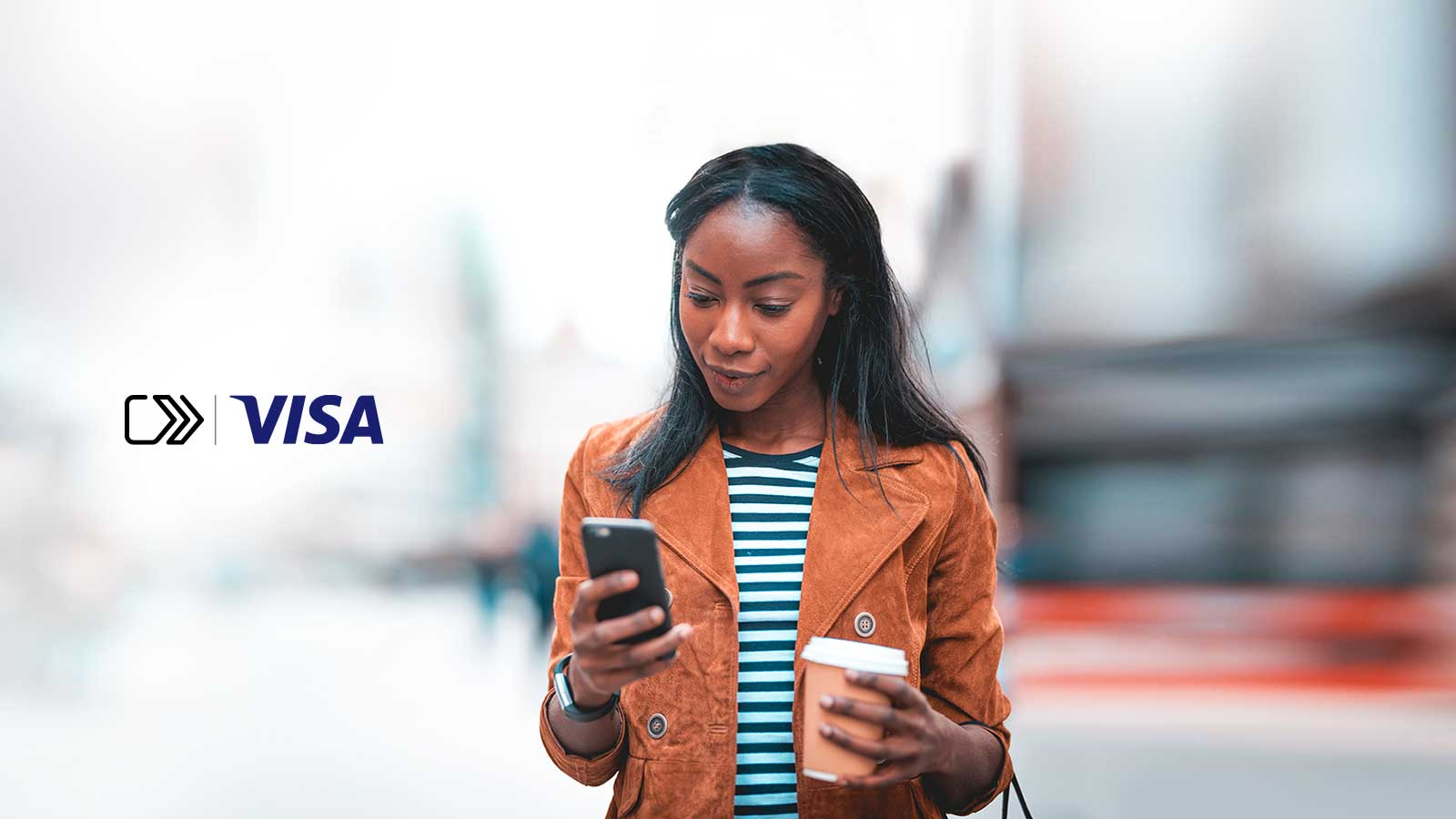 A young woman, uses her phone while holding a cup of coffee and  SRC icon and Visa logo on left side of the image.