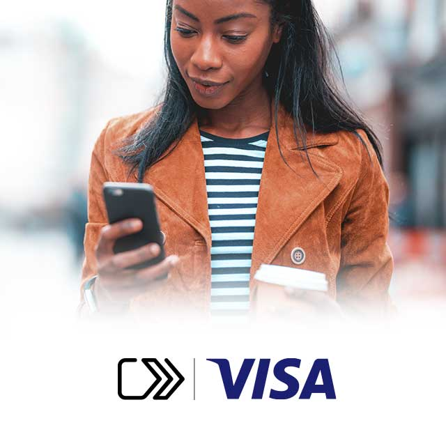 A young woman, uses her phone while holding a cup of coffee and  SRC icon and Visa logo on the bottom of the image.