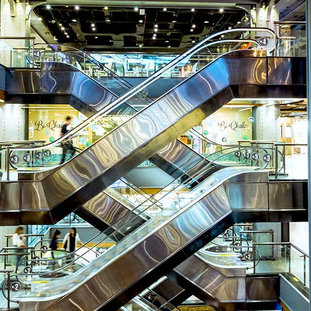 modern escalators inside a building