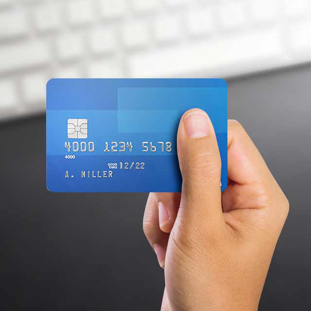 A close up of hand holding a credit card.