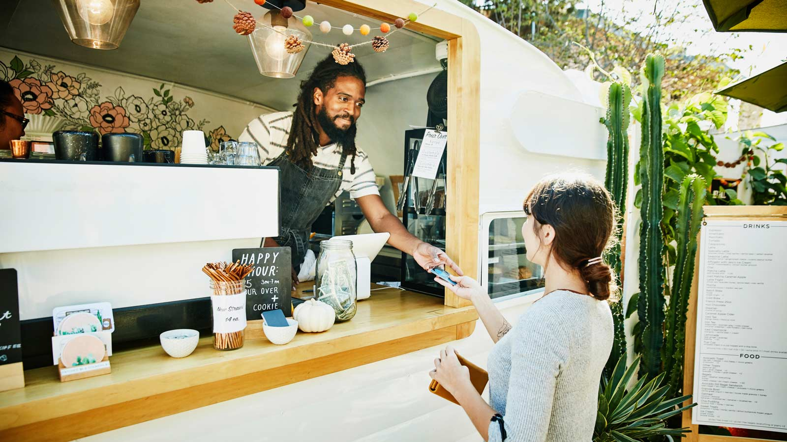 Food truck merchant accepting credit card payment.