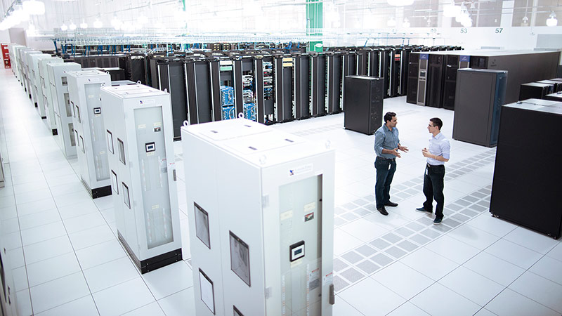 Two men talking in data center room.