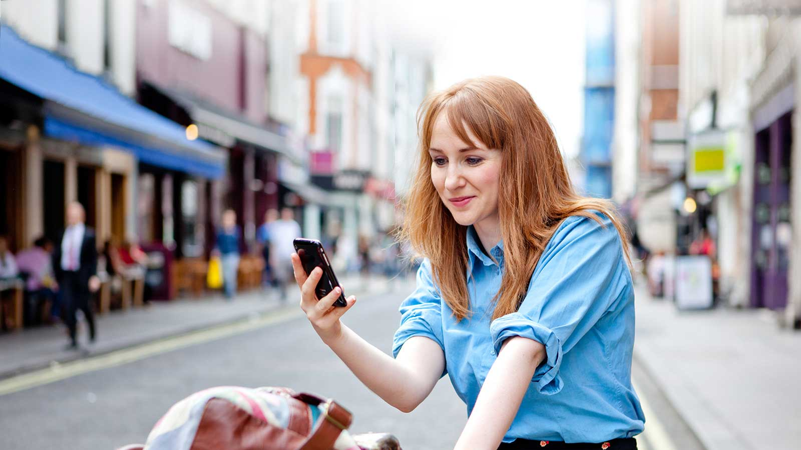 woman looking at a mobile phone