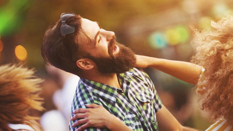 Bearded man dancing with woman