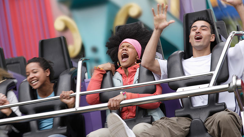 Two women and a man on a rollercoaster