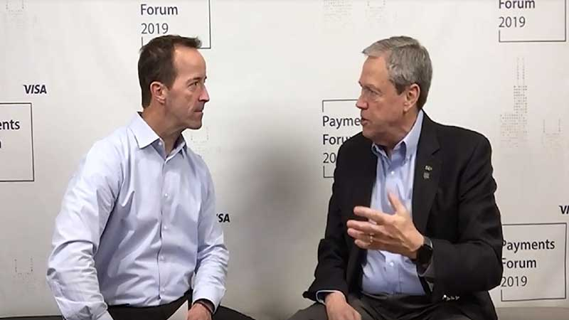 Cam Fine talking to an interviewer at the Visa Payments Forum 2019.