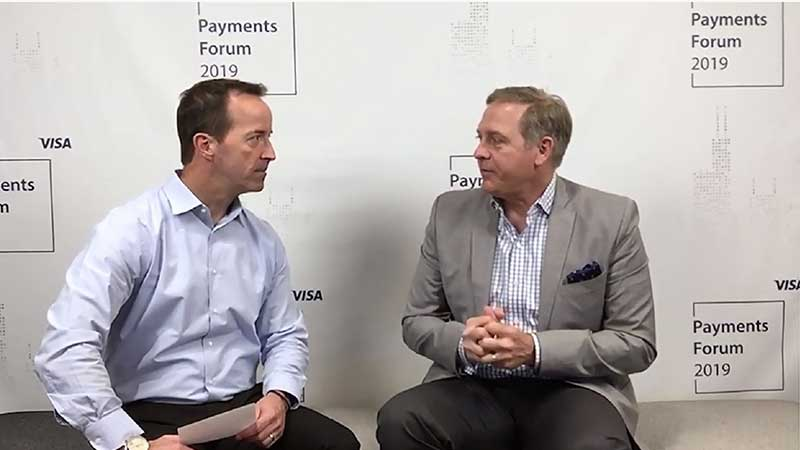 Doug Leighton talking to an interviewer at the Visa Payments Forum 2019.