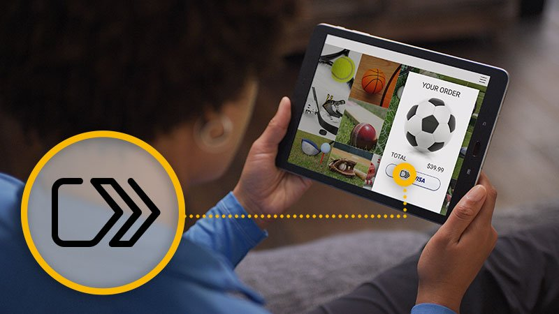 A person is shopping online for soccer gear using a tablet, and the click to pay button which allows for easy shopping is highlighted.