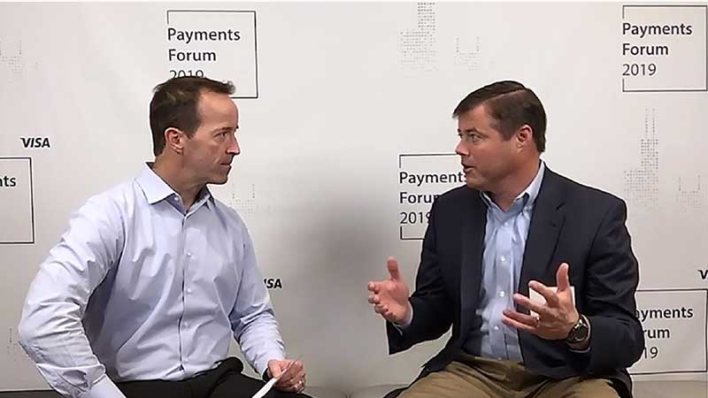 Tom Brooks talking to an interviewer at the Visa Payments Forum 2019.