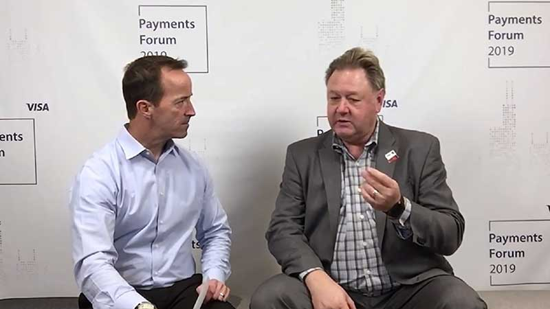 Wayne Best talking to an interviewer at the Visa Payments Forum 2019.