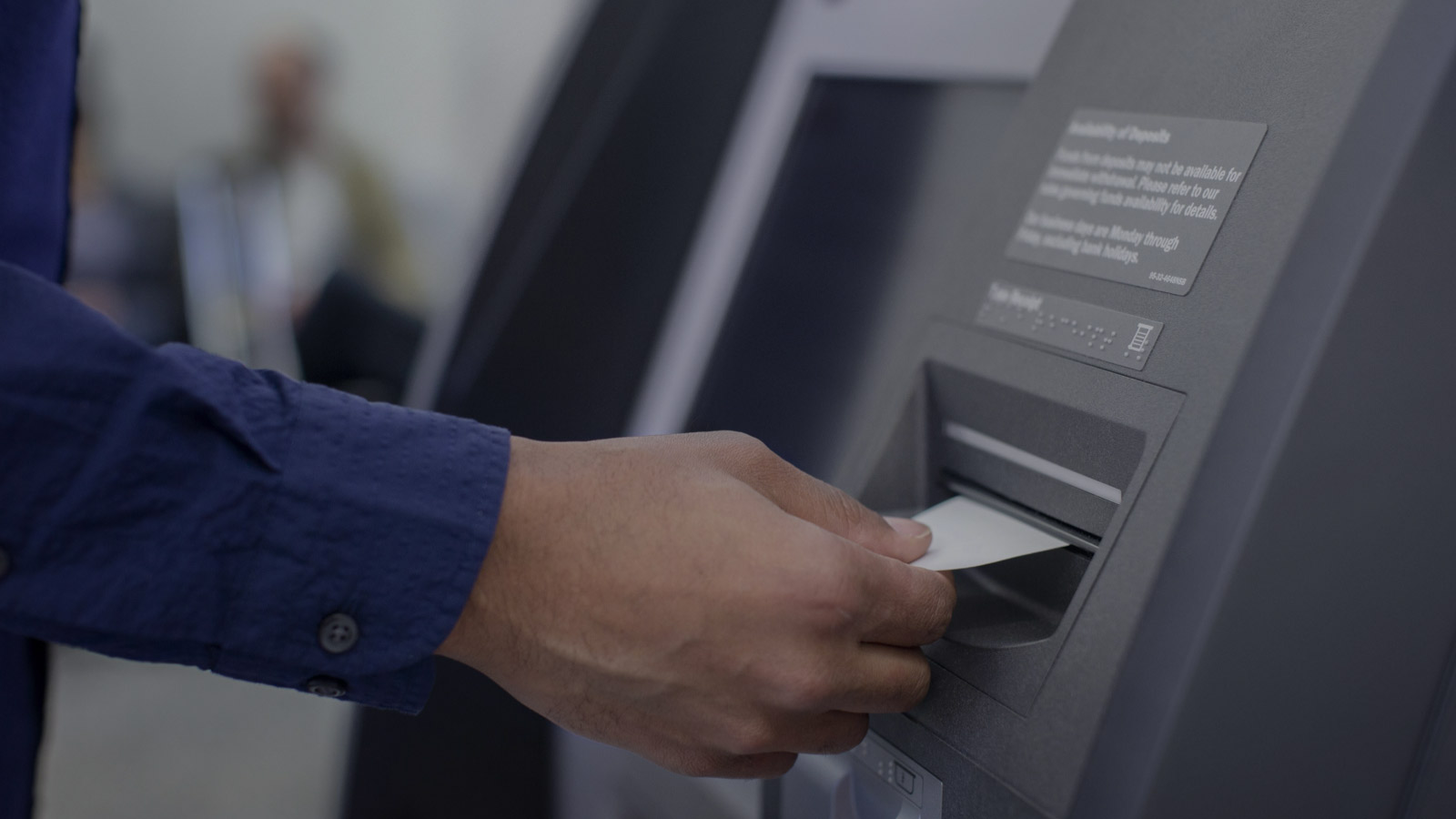 Removing ATM receipt after transaction.