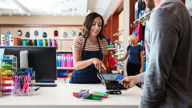 Man an in-store retail purchase using card.