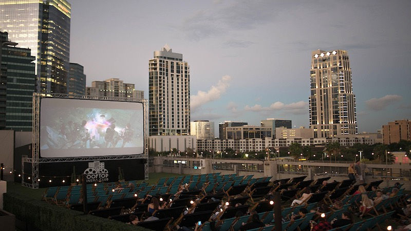 Aerial view of outdoor rooftop movie screen and seats.