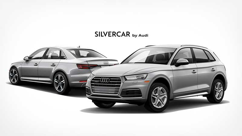 Silvercar by Audi: Two silver Audi cars parked near each other.
