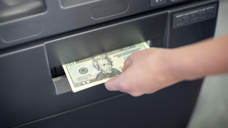 Taking cash from a surcharge-free ATM transaction.
