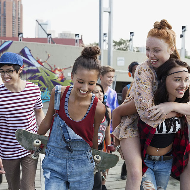 Group of smiling teens walking together