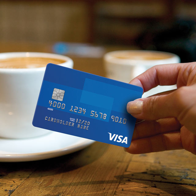 two coffees and woman holding credit card