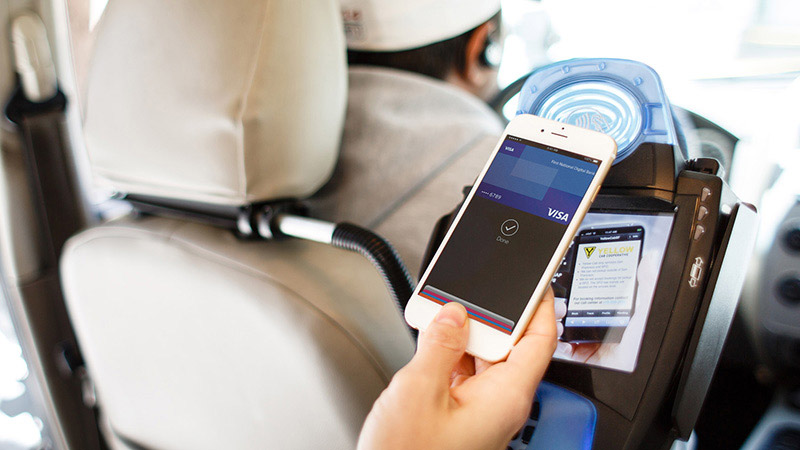 Using a mobile phone in taxi to pay.