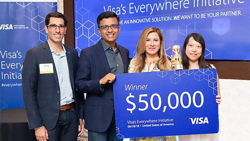 Visa Everywhere Initiative winners holding big fifty thousand dollar check.